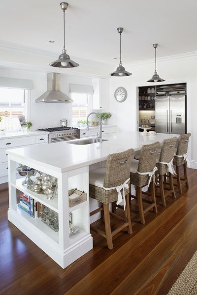 kitchen - doesn't show much storage but I like the island with the stools and the two shelves on the end: