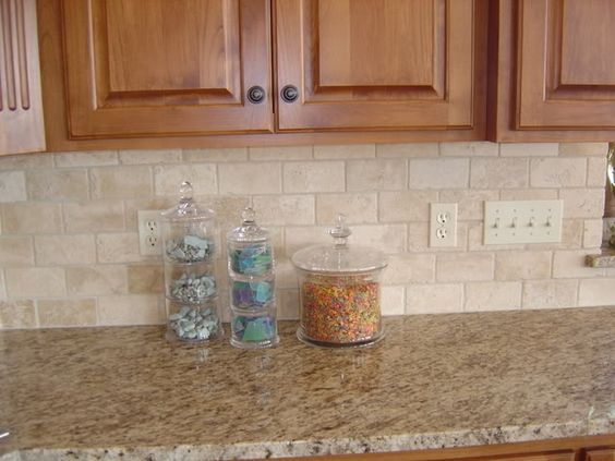 Heres a simple beige colored kitchen backsplash with a granite