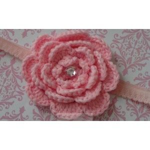 $7 A crochet flower with a jewel on a lace headband.