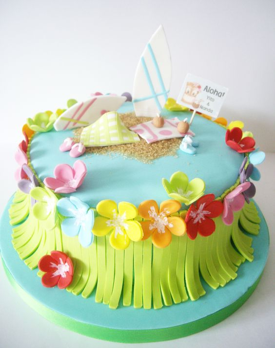 They've had a beach cake so not too sandy, but the flowers and grass skirt are fun.
