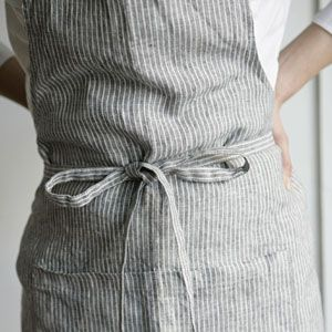 Full apron in grey and white striped linen from fog linen work.