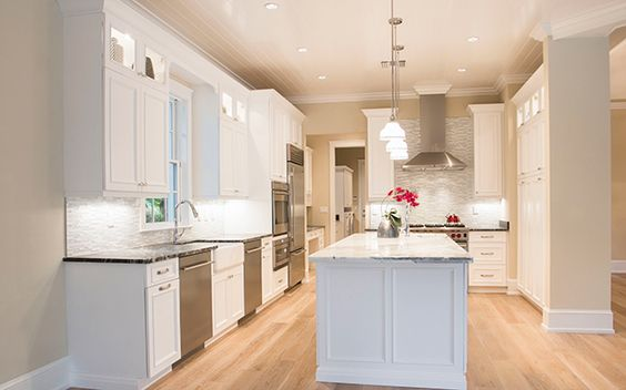 Clean White Kitchen Bleached Wood Floor Stone Backsplash Kitchens By Clay Naples Florida