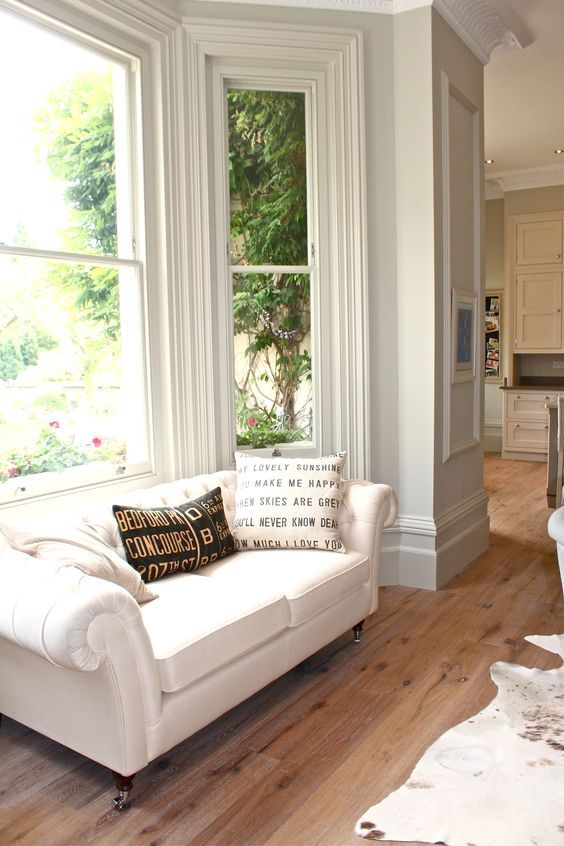 White Chesterfield sofa by Marks and Spencer's. Walls in Farrow and Ball Shaded White. Modern Country Style: Kate's Creative Space Full Home Tour Click through for details.: