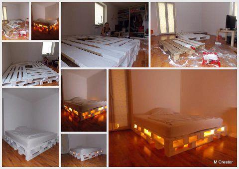 Cama feita de paletes com luminarias...
