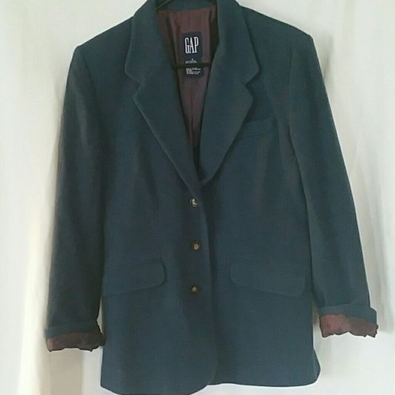 GAP Wool Blend Blue Blazer GAP Wool Blend Blue Blazer.  Used condition.  Warm and comfy.  Material is 55% wool / laine, 30% nylon, and 15% angora.  The lining of the jacket is 100% acetate. GAP Jackets & Coats Blazers