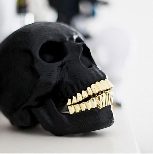 black #skull with shiny gold teeth