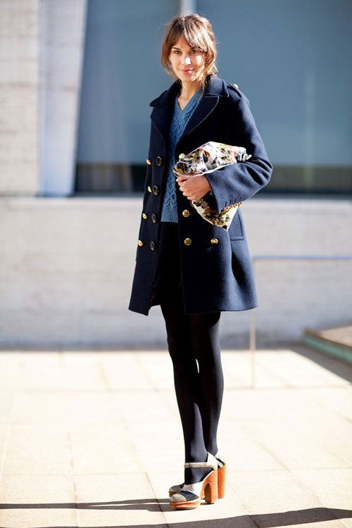 Alexa Chung. Navy blue military-inspired pea coat with gold