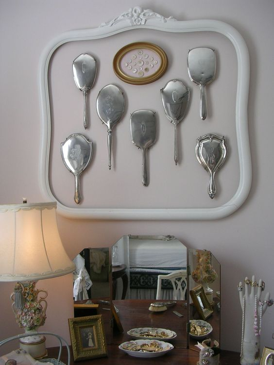Grouped vintage engraved hand mirrors inside old empty frame. Kept letters I wrote my parents from college, an old photograph of my grandparents, and other family treasures.