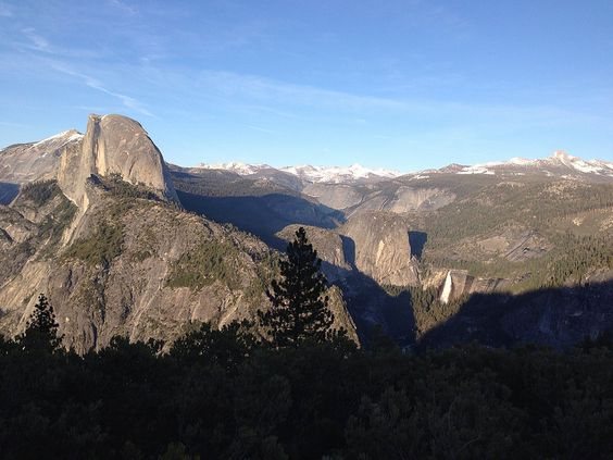 View of Half Dome and snow capped mountains from Glacier Point