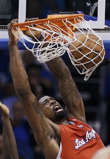 Los Angeles Clippers' DeAndre Jordan dunks against the Orlando Magic during the first half of an NBA basketball game, Wednesday, Feb. 6, 2013, in Orlando, Fla