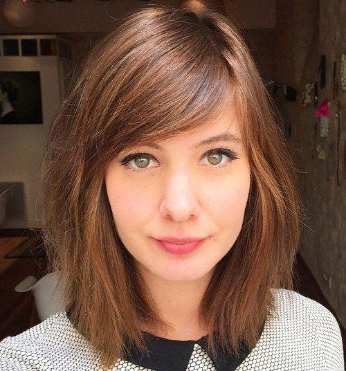 Medium Razored Haircut With Side Bangs