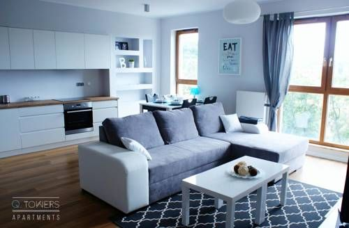 QTowers Apartments Piecki Set in Piecki, this air-conditioned apartment features a terrace. Guests benefit from free WiFi and private parking available on site.  There is a seating area, a dining area and a kitchen as well as a private bathroom.