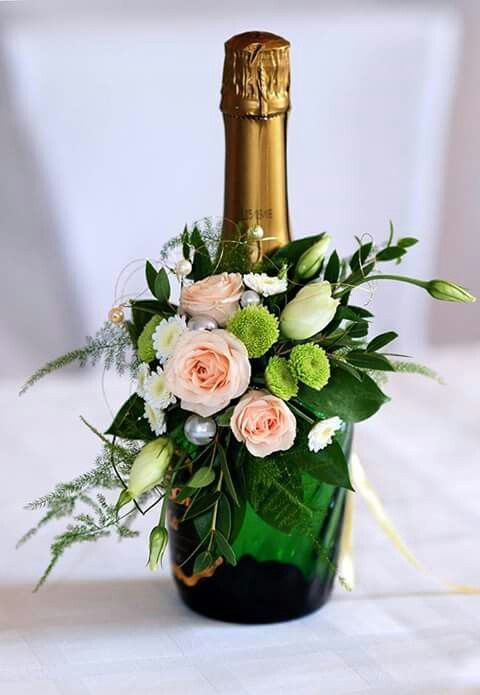 Lavishness! Showstopper floral idea for amping up champagne bottles. | These 20 Unique Floral Centrepiece Ideas Are Irresistibly Screenshot-Worthy! | Function Mania