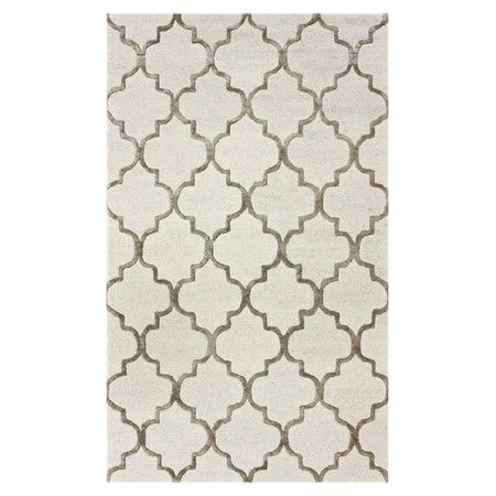 Anchor your dining table or define a space in the den with this hand-tufted wool and art silk rug, showcasing a chic quatrefoil motif  ...