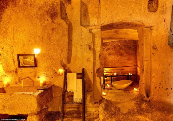 Golden glow: The caves are illuminated with soft candlelight, adding to the romantic atmos...