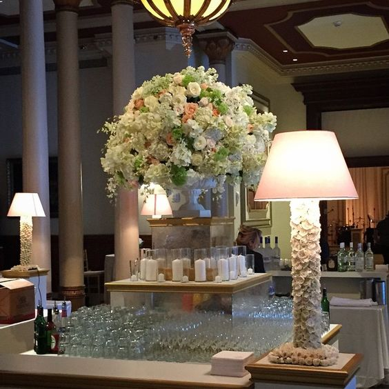 Love these lamps created from fresh spray rose blooms. #sewellmates #jacksondurham #eventdesign #weddingdesign #floraldesign