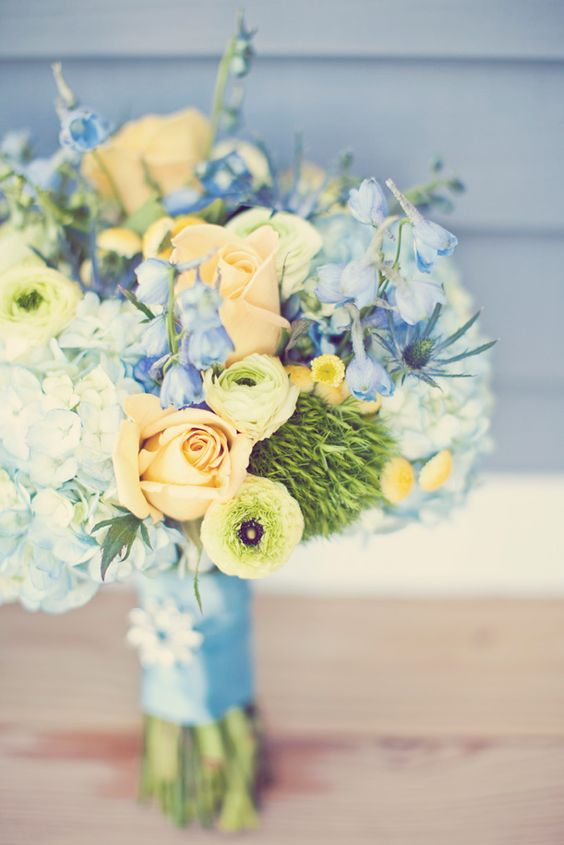 Gorgeous blue & yellow flowers from a Door County Wedding.