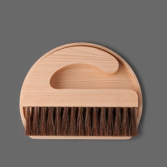 Table broom and dust pan.