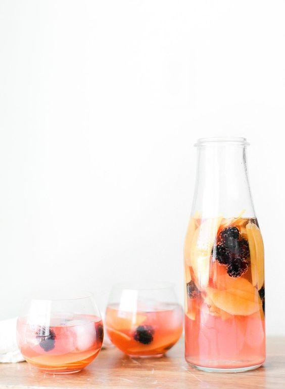 Mango sangria -1 bottle of Marques de #Caceres rose wine -1/4 cup brandy -2 tbsp raspberry liqueur -2 tbsp sugar -1 mango -1 1/2 cups of fresh blackberries -3 cups club soda -Ice