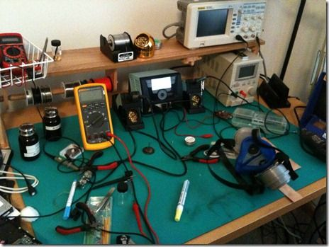 Electronics workbench with green mat.