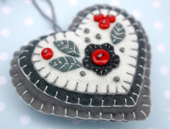 Red and grey handmade felt heart Christmas ornament.  Handmade felt hanging heart with layers of applique and embroidery in greys and white, embellished with tiny red buttons.  A perfect gift or decoration .  9cm x 8cm approx, with a cotton loop for hanging.  You can see more felt heart ornaments here; https://www.etsy.com/ie/shop/PuffinPatchwork?ref=hdr_shop_menu&section_id=19324374