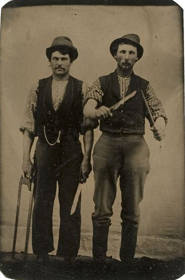 Occupation. Tintype portrait of two butchers wielding knives. ca.1860-1880.  via Cowan's Auctions: