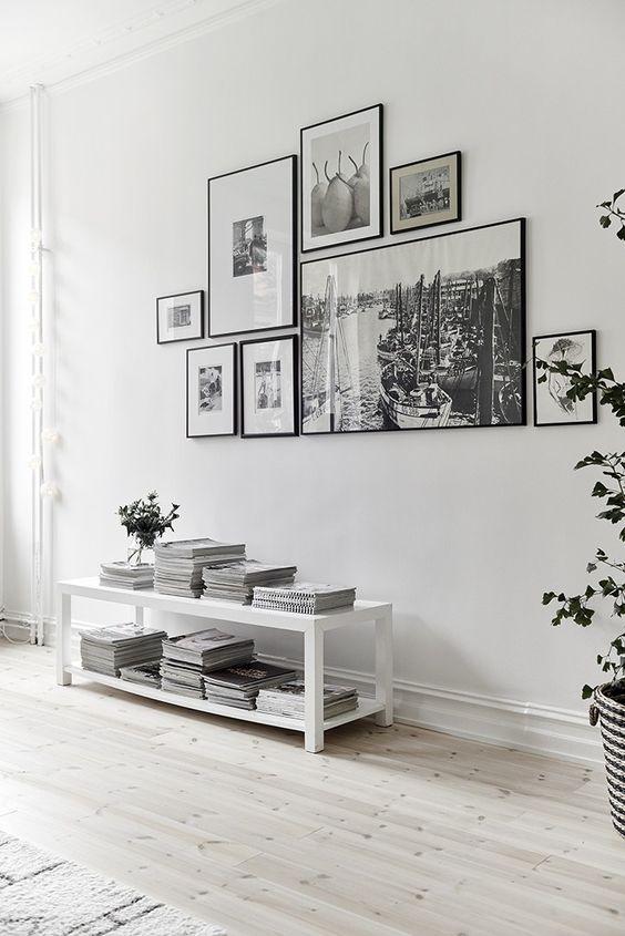 zwarte lijsten en zwart witte foto's combineren op de muur