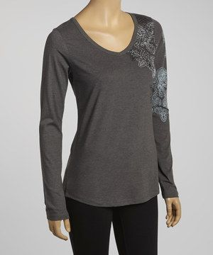 This terrific top is perfect for layering. With a paisley pattern and feminine fit, it's sure to become a fast fashion favorite!