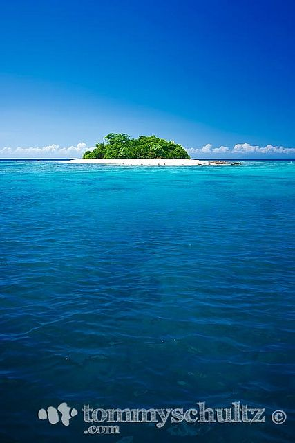 A small tropical island beach surrounded by blue water Small islands around the world