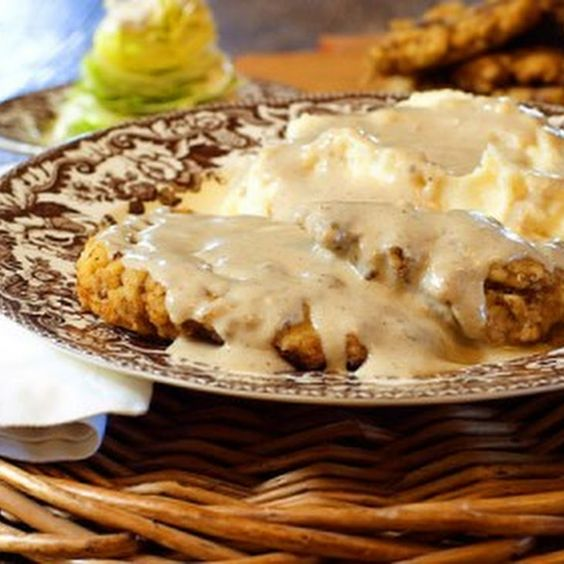 Chicken Fried Steak Recipe Main Dishes with cube steaks, whole milk, gravy, large eggs, all-purpose flour, seasoning salt, cayenne, black pepper, canola oil, meat, gravy, salt, pepper, russet, butter, cream cheese, half & half, seasoning salt, black pepper
