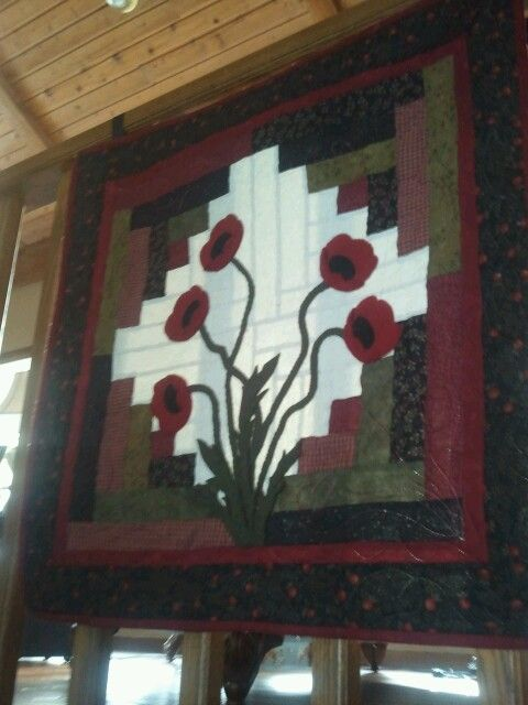 French Country Farmhouse -          After Christmas decorating at our farmhouse includes hanging colorful quilted pieces in the stair railing  - the colorful red poppies help warm up my heart in this COLD weather season --