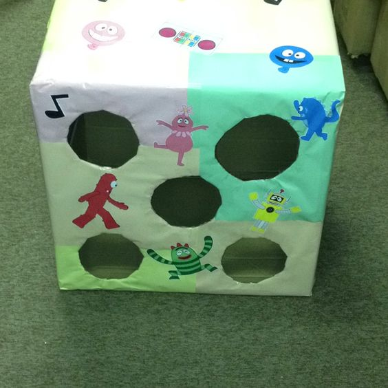 Yo Gabba Gabba bean bag toss! You take a box cover it with colorful paper print off printables at Nick Jr. .com and glue them on with a glue stick!!