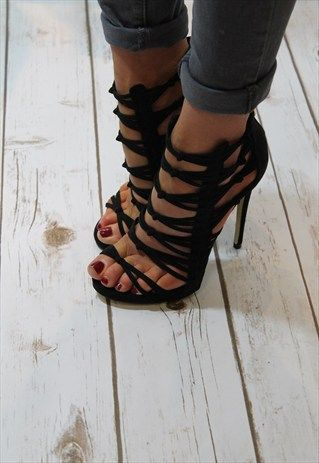 Very sexy stiletto heels, perfect for pairing with all of your outfits this season. Features: An open toe. Caged strappy Ankle high body. Gold zip closure to the back. 12cms (4 3/4 inch)heel. fastening, a strappy design, and a high 4 half stiletto heel.