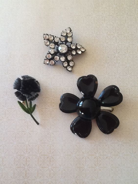 A personal favorite from my Etsy shop https://www.etsy.com/listing/465485759/destash-vintage-black-enamel-and