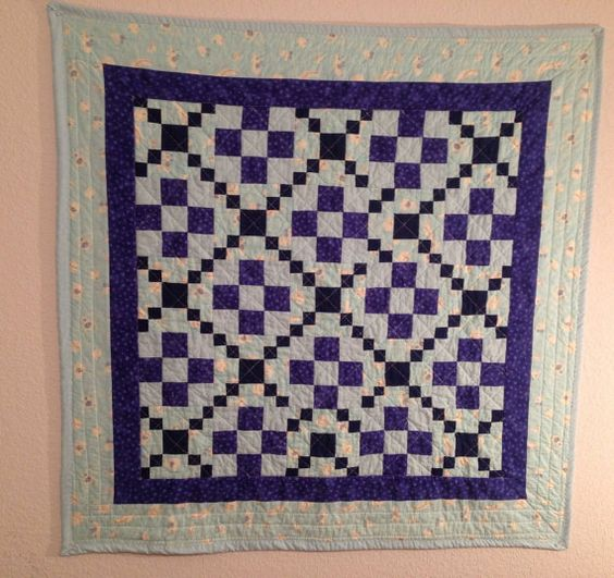 Baby quilt 38 x 38 100% cotton in a 9 patch variations of blues/purples