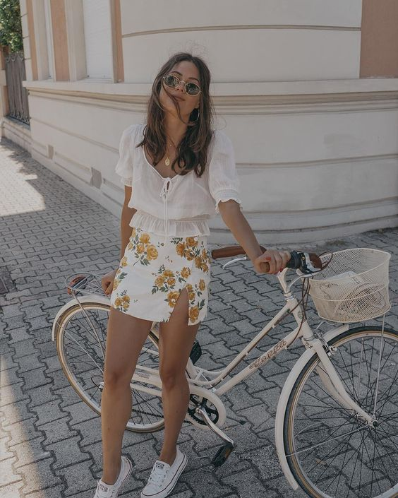 """Sarah Butler on Instagram: """"Happy happy happy 😊 Sharing our bike ride on instastories 🚲🇮🇹 Wearing @revolve floral skort and @hm top http://liketk.it/2wzsY"""""""