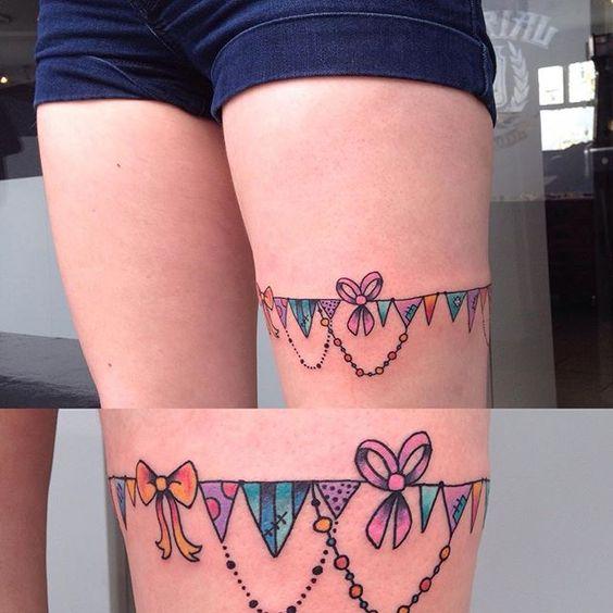Bunting leg garland tattoo, by Amy Tenenbaum, Carousel Custom Tattoos, Newbury ✨