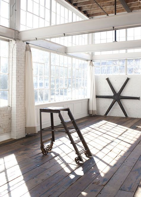 @Dana Puhl  It's awesome when a room, and a rustic one at that, is left empty and white, with light and impurites..bare boards, even some strange ripped wallpaper. Great canvas for a studio.