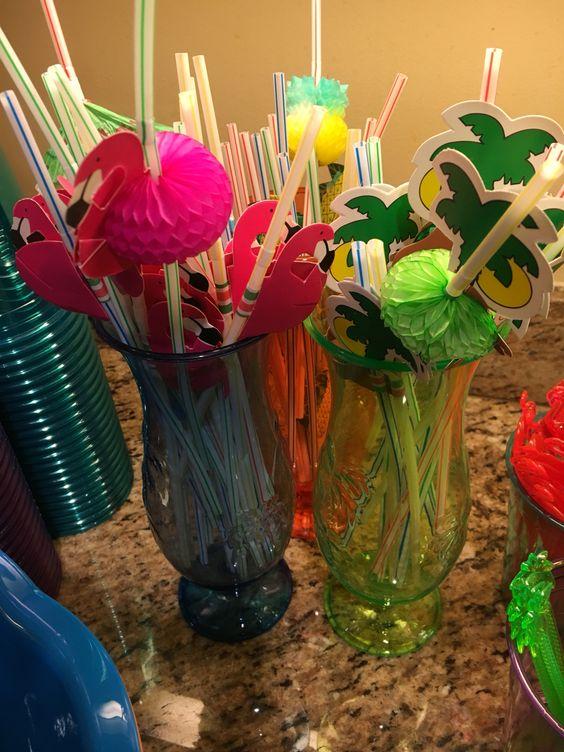 Festive straws in cocktail glasses