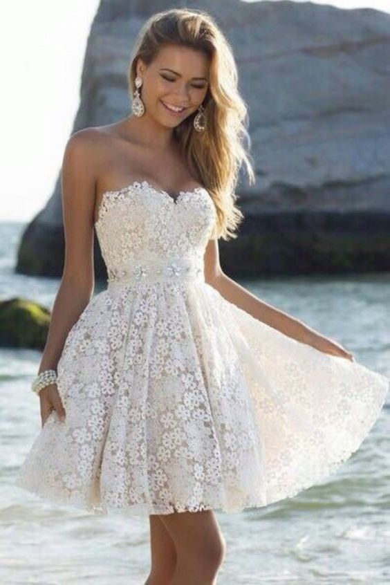 Short white lace dress with pearl waistband