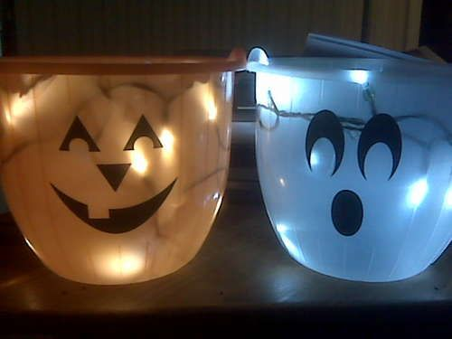 Glowing Halloween Trick or Treat Bag: DIY with inexpensive plastic buckets and inexpensive battery powere white LED Christmas lights. This is both fun and a good safety light.