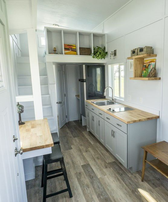Below The Loft Is The Bathroom With Full Size Shower Flush Toilet And Vanity With Storage Small House Kitchen Design Tiny House Kitchen House Design Kitchen