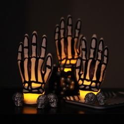 Spooky skeleton hand decorations--all you need is latex gloves and a permanent marker!