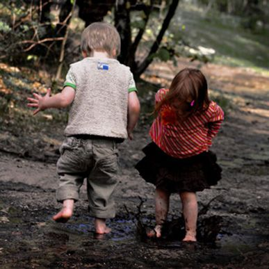 Twin playing in the mud having fun!