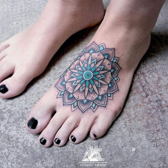 Mandala foot tattoo - A really pretty mandala foot tattoo. This tattoo is done in colored ink and as you can see, bright colors have been used to create a positive and bright aura from the mandala.: