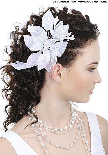 Seitlich gesteckte Locken mit großer Blüte / Braut-Frisuren