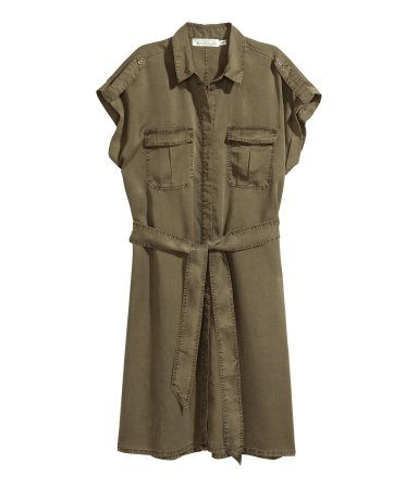 Khaki green. CONSCIOUS. Straight-cut shirt dress in Tencel® lyocell fabric. Collar, concealed buttons, shoulder tabs with button, and cap sleeves with sewn