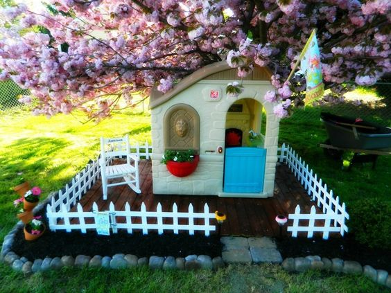 Not your average playhouse! Easy way to make those tacky plastic playhouses look cute in your backyard!