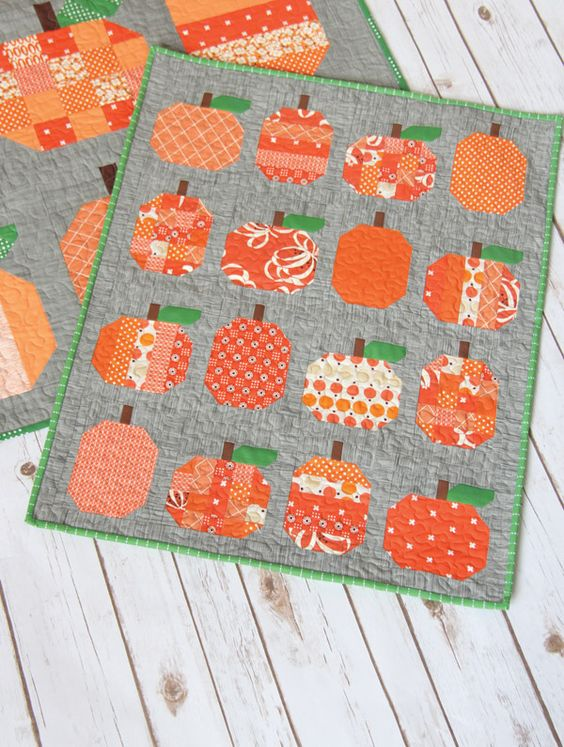 It's no surprise that I could hardly wait to make a mini version of the Pumpkins pattern! I decided to make this mini a little bigger than my other minis. It measures 23 1/2″ x 29″ finished, so it mak