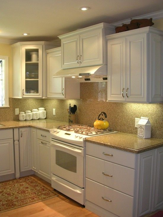 Traditional kitchen white cabinets white appliances design for Traditional kitchen appliances